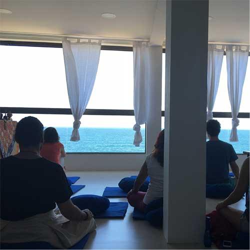 meditators in the shrine room of Guna Norling
